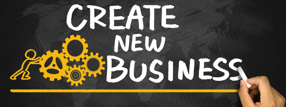 create new business concept handwritten on blackboard